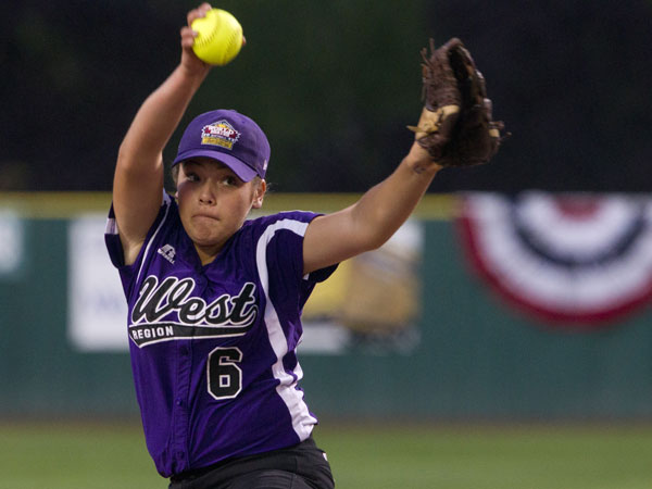 Team West pitcher Jazmine Ayala in action Wednesday. Team Southeast from McLean, Virginia was defeated 9-0 by Team West from Tucson, Ariz., in the 2013 Little League World Series Championship game Wednesday night Aug. 14, 2013 in Portland. (AP Photo/The Oregonian, Ross William Hamilton)