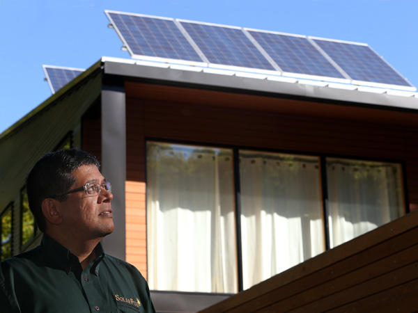 Mouli Vaidhyanathan, President of Mouli Engineering, stands in front of a home in St. Paul, Minnesota, where the homeowner had installed two of his company´s SolarPod panels. (Joel Koyama/Minneapolis Star Tribune/MCT)
