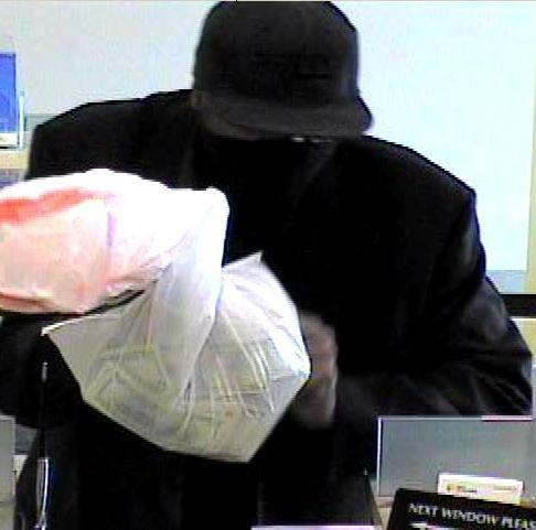 The bank robbery suspect told a teller that he was carrying a bomb, FBI officials said. (FBI photo)