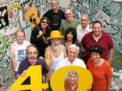 South Street regulars (front to back, left to right): Ruth Snyderman, Ron Kaplan, Rick Snyderman, Julia Zagar, George Manney, Isaiah Zagar, Susan Lunenfeld, Bill Curry, Kenn Kweeder, Warren Muller, Joel Spivak, Tom Bissinger.