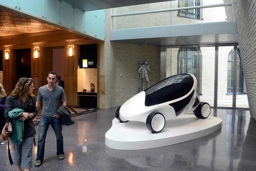 "Outside the Zaha Hadid installation at the Philadelphia Museum of Art Perelman Building, visitors view ""Z-Car I"" (2005-6), three-wheeler."