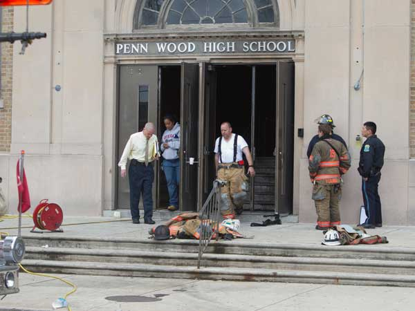 A fire at Lansdowne´s Penn Wood High School forced officials to cancel classes for a few days. Here, officials and fire personnel exit the school after evaluating damage ( ED HILLE / Staff Photographer )