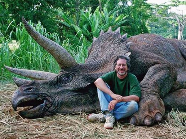 """A satirical Facebook post with this photo of Steven Spielberg may have fooled some people who thought he killed a dinosaur. The text read: """"Disgraceful photo of recreational hunter happily posing next to a Triceratops he just slaughtered. Please share so the world can name and shame this despicable man. """""""