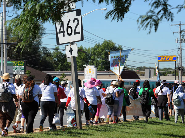 The 100 women march down Route 462 in York at the outset of their 100-mile trek to Washington. (BRADLEY C BOWER/For The Inquirer)
