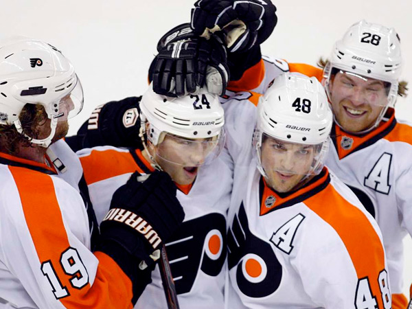 "Flyers (from left) Scott Hartnell, Matt Read, Danny Briere, and Claude Giroux. ""I cannot wait to return,"" Giroux said. AP"
