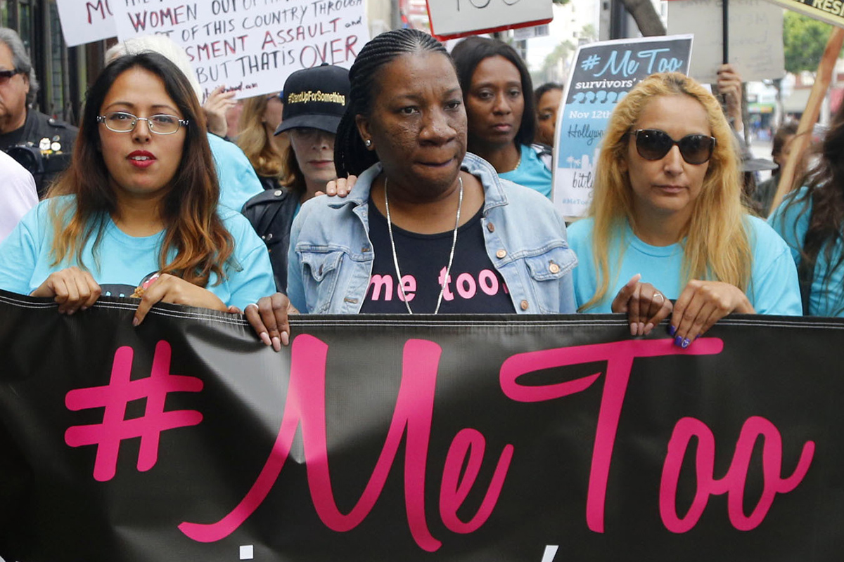 "Tarana Burke ( center ) originated the Me Too movement a decade ago. The ""Silence Breakers"" of the #MeToo movement have been named Time's person of the year.  Tarana Burke, center, joins participants marching against sexual assault and harassment, Los Angeles, Sunday, Nov. 12, 2017"