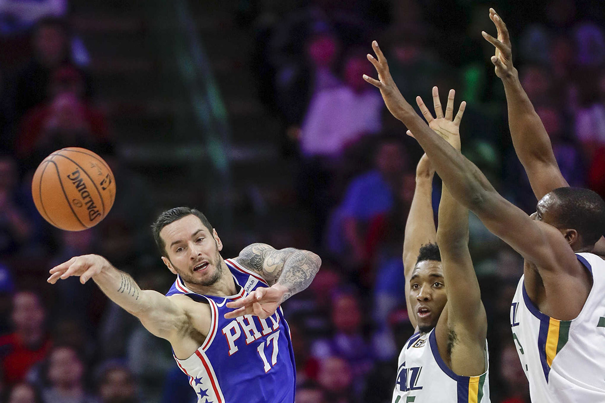 Sixers forward JJ Redick passes the basketball past Jazz guard Donovan Mitchell and center Ekpe Udoh.  YONG KIM/Staff Photographer