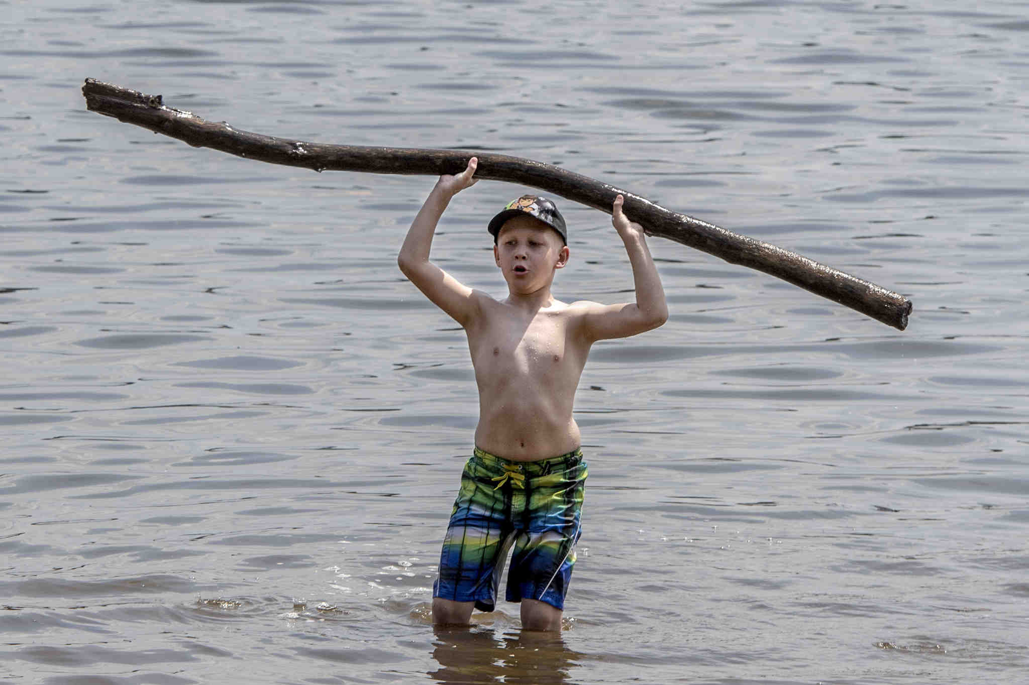 Jacob Winski, 8, pumps some wood -- it´s a log -- along the shores of the Delaware River at Neshaminy State Park July 17, 2017.  He and his family are from the Northeast.