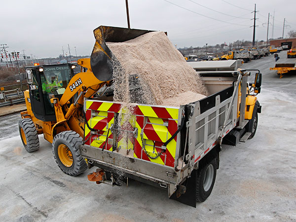 PennDot workers load up trucks with salt in preparation for a storm coming to the Philadelphia area. (Michael Bryant / Staff Photographer)