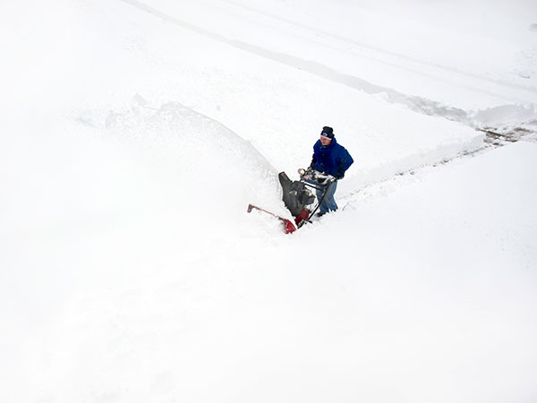 Dave Ennis, 54, guides his snowblower to clear his neighbor´s driveway in the Hopewell development of East Brandywine Feb. 13, 2014.  The winter Nor´easter dumped about 15 inches of snow in the neighborhood.  ( CLEM MURRAY / Staff Photographer )