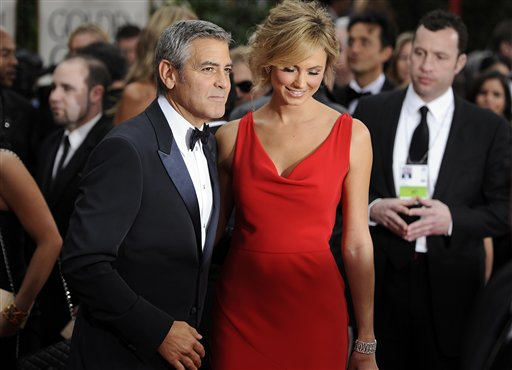 George Clooney, left, and Stacy Keibler arrive at the 69th Annual Golden Globe Awards Sunday, Jan. 15, 2012, in Los Angeles. (AP Photo/Chris Pizzello)