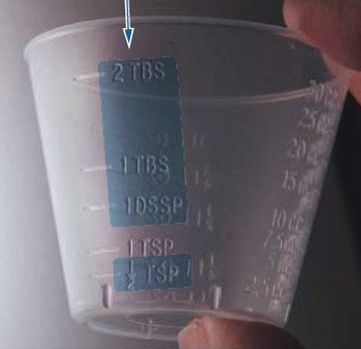 Measuring cup with both TBS (tablespoon) and TSP (teaspoon) markings.