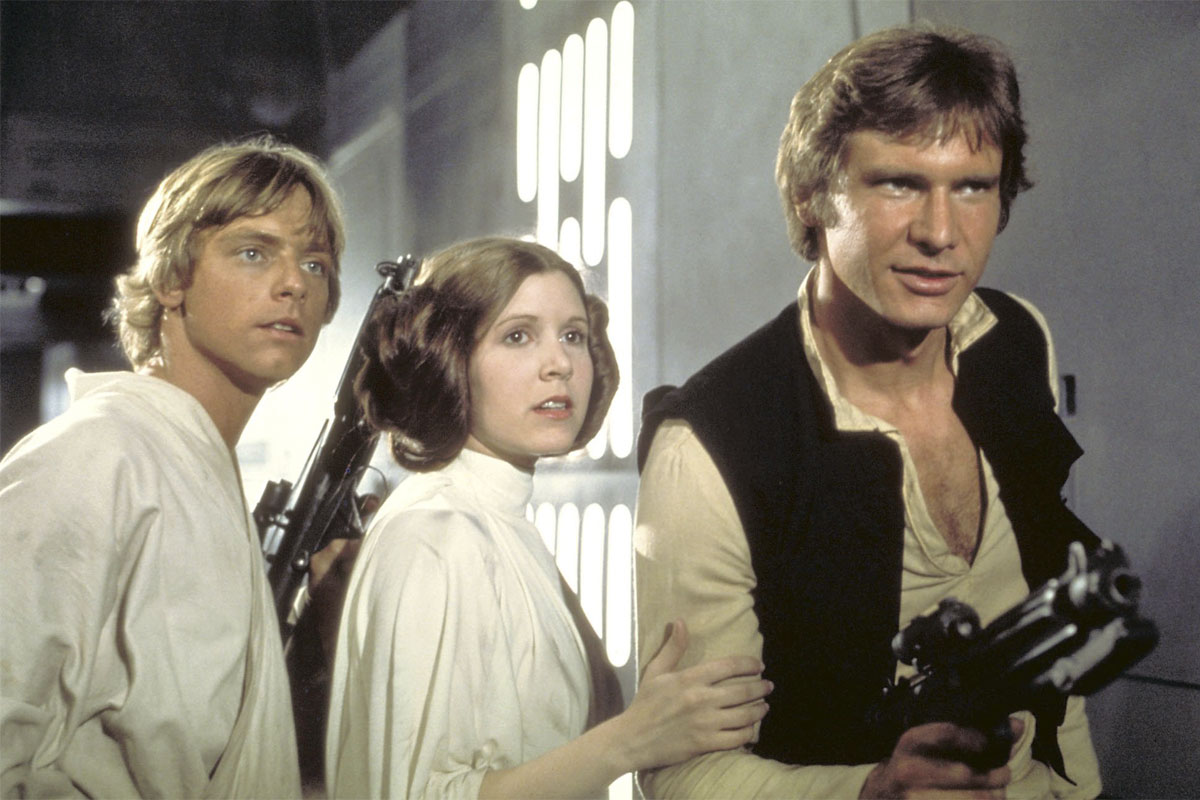 """Mark Hamill ( from left) as Luke Skywalker, Carrie Fisher as Princess Leia Organa, and Harrison Ford as Hans Solo in the original 1977 """"Star Wars: Episode IV - A New Hope."""""""