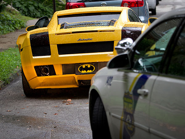 Philadelphia police sit on a stolen Lamborghini along 400 block of Upsal St. in Mt. Airy section of Philadelphia on Tuesday, July 23, 2013. This car was stolen from East Falls section of city earlier in the day. (ALEJANDRO A. ALVAREZ / STAFF PHOTOGRAPHER)