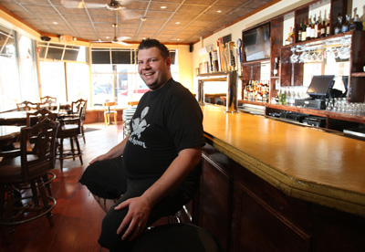 Mike Stollenwerk at the bar of Fathom, 200 E. Girard Ave. (Photo: MICHAEL BRYANT / Staff Photographer)