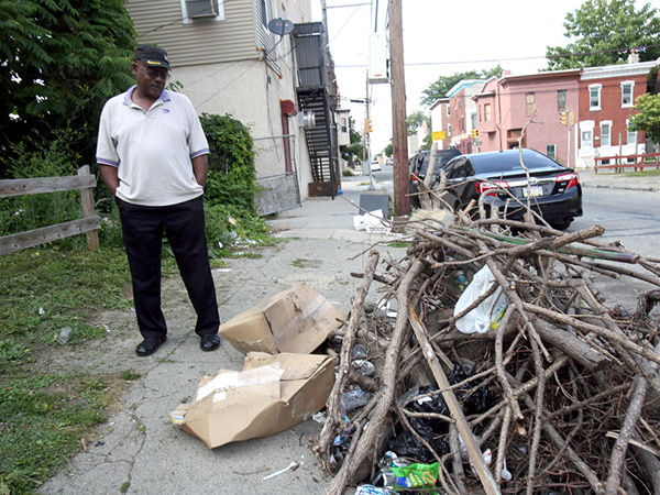 Talmadge Belo points out trash in his North Philadelphia neighborhood on June 15, 2015. ( STEPHANIE AARONSON / Staff Photographer )