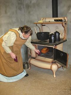 Sheila Walter demonstrates Victorian-era cooking on a cast-iron stove.