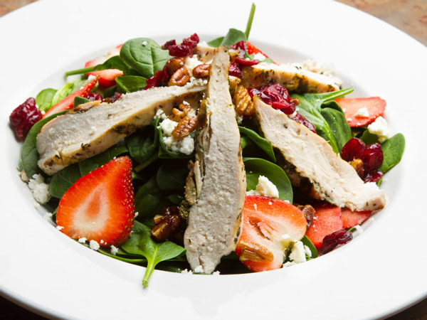 This strawberry and chicken salad only takes 20 minutes to make! It combines strawberries with tangy vinaigrette, chicken, and blue cheese.