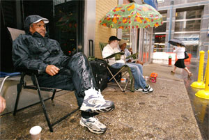 Mayor John Street waits in line for the chance to buy the new iPhone.