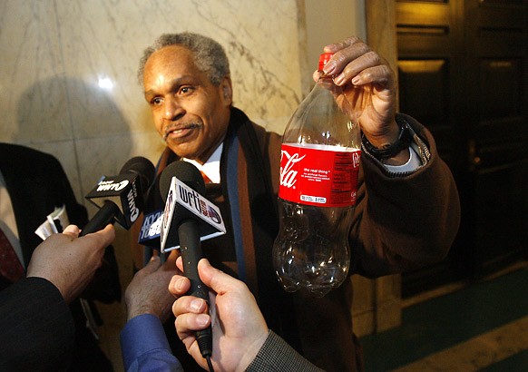 Former Philadelphia mayor John Street comments on the soda tax by holding a bottle of Coca-Cola.