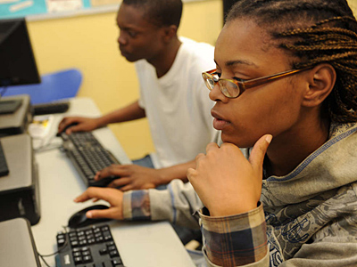 YESPhilly students April Bryant, 21, and Robert Goodson, 18, study a software program.