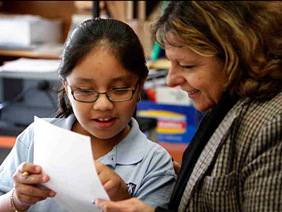Abigail Centeno, 9, goes over a story with adviser Cheryl Levine at Hancock Elementary. (Laurence Kesterson/Staff)