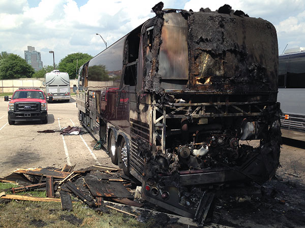 A burned bus near Penn´s Landing, originally hired to transport crew supporting the classic rock bands Styx and Foreigner. (Cindy Stansbury/Staff)