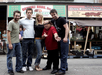 The cast mugs on Ninth Street during shooting in June: Charlie (Charlie Day), Dennis (Glenn Howerton), Dee (Kaitlin Olson), Frank (Danny DeVito) and Mac (Rob McElhenney).