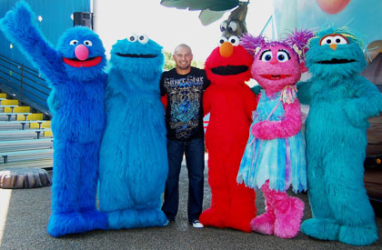 Victorino with Grover, Cookie Monster, Elmo, Abby Cadabby and Rosita.