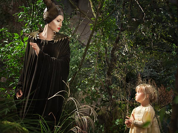 "This image released by Disney shows Angelina Jolie as Maleficent,left, in a scene with her daughter Vivienne Jolie-Pitt, portrayingYoung Aurora, in a scene from ""Maleficent."" (AP Photo/Disney, FrankConnor)"