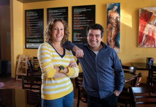 Owners Avital Mentel and Fabrice Saadoun in their new Ardmore restaurant, Hummus. (Ed Hille / Staff Photographer )