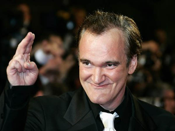 "American director Quentin Tarantino arrives for the screening of the film ""Death Proof,"" at the 60th International film festival in Cannes, southern France, on Tuesday, May 22, 2007. (AP Photo/Francois Mori)"