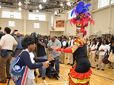 Junior Shaquae Patty dances with Fatima Peters of Brazil Production dancers after an opening day ceremony at the new West Philadelphia High school. (Ron Tarver / Staff Photogapher)