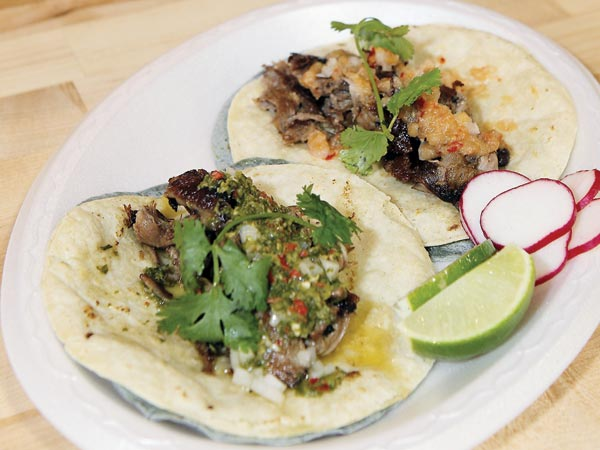 """Classic"" lamb tacos with wedge of lime at the Border Springs Farm lamb stand in Reading Terminal Market.