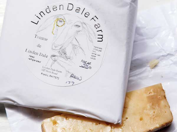 Tomme de Linden Dale, a hand aged natural goat cheese from Linden Dale Farm. ( MICHAEL S. WIRTZ / Staff Photographer )