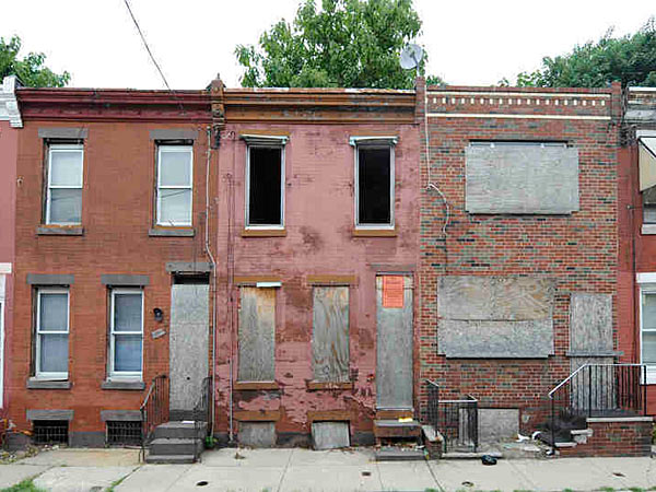 The 2300 block of Gerritt Street in Point Breeze includes three vacant houses. The city´s lack of an efficient system for dealing with abandoned, tax-delinquent properties means such sites often remain festering for many years. In other cities, they would be cleared off within as little as a year.