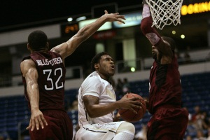 Purdue's Terone Johnson, center, goes up for a shot against Temple's<br />Rahlir Hillis-Jefferson, left, and Anthony Lee during Friday&acute;s game in San Juan, Puerto, Rico  (AP<br />Photo/RicardoArduengo)
