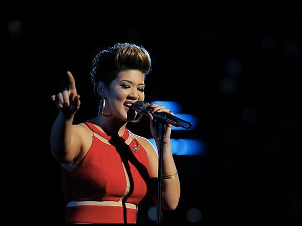 Tessanne Chin performs on The Voice.
