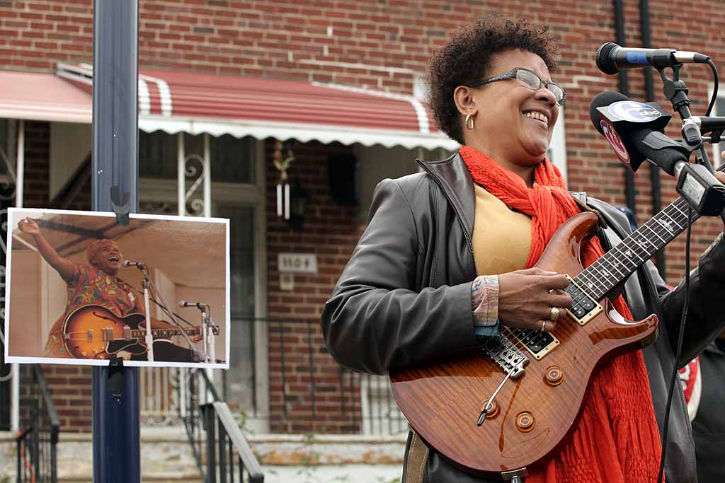 """Jazz musician Monnette Sudler plays at the unveiling of the historical marker at the North Philadelphia home of Sister Rosetta Tharpe, shown in the small photo. Called the """"godmother of rock and roll,"""" Tharpe lived at 11th and Master."""