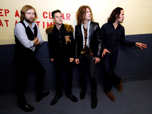 The Las Vegas based rock band The Killers pose for a photo Friday, Oct. 24, 2008 at the Hammerstein Ballroom in New York City. They are (L-R) Bass player Mark Stoermer, vocalist Brandon Flowers, lead guitarist Dave Keuning and drummer Ronnie Vanucci, Jr.. (AP Photo/Stephen Chernin)