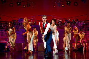 "Aaron Tveit, center, performs in ""Catch Me If You Can."" (AP Photo/The Hartman Group, Joan Marcus)"