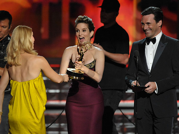 "Tina Fey, center, and Jon Hamm, right, present the award for outstanding lead actress in a drama series to Claire Danes for ""Homeland"" at the 64th Primetime Emmy Awards at the Nokia Theatre on Sunday, Sept. 23, 2012, in Los Angeles. (Photo by John Shearer/Invision/AP)"