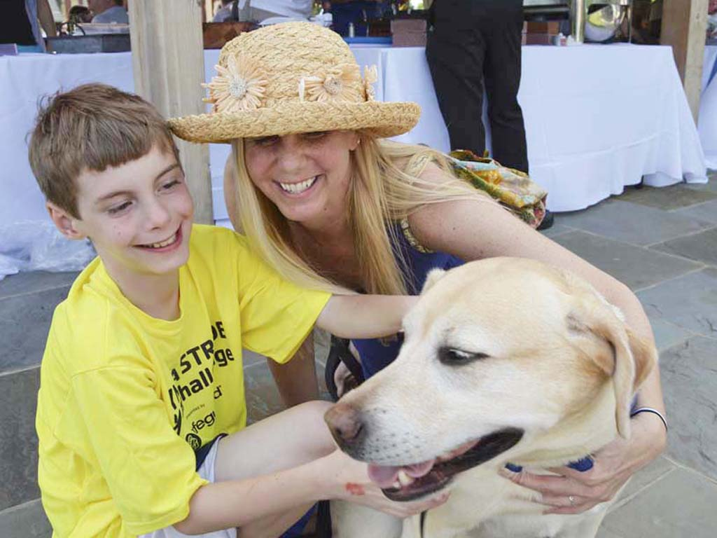 Charlie Eissel, (left),  with his service dog Andy and his Mom, Shari, at the 30th Canine Partners for Life Pawty at the Preserve May 30, 2015 at the Lenfest Center at Ches Len Preserve in Coatesville.<br /> ( For the Inquirer / Maggie Henry Corcoran )