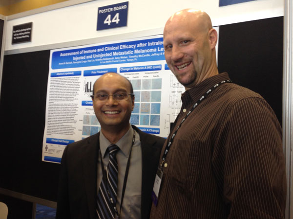 T.J. and Dr. Amod Sarnaik, the lead oncologist on his first clinical trial, presenting trial data at ASCO 2014