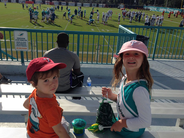 Tommy and Josie watch the Miami Dolphins practice.