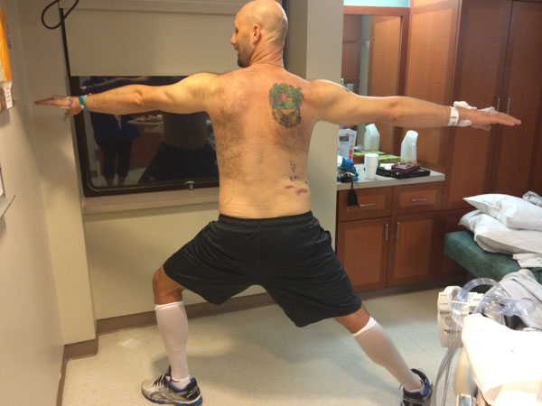 TJ practicing yoga in the recovery room at MD Anderson.