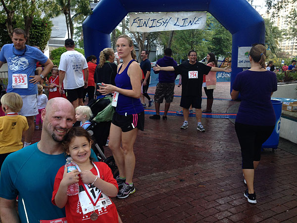 TJ and Josie at the finish line of the Riverwalk Run.