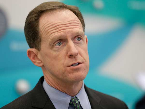 File photo: Sen. Pat Toomey, R-Pa. speaks to a member of the media at Temple University Hospital on Monday, March 11, 2013, in Philadelphia. (AP Photo/Matt Rourke)
