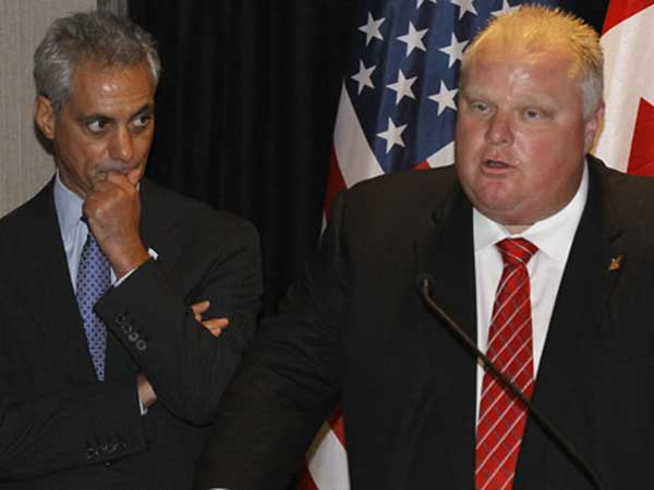 "Toronto Mayor Rob Ford, right, makes a few remarks as Chicago Mayor Rahm Emanuel listens, before the pair signed a new ""sister cities"" agreement Wednesday, Sept. 19, 2012, in Chicago. (AP Photo/Charles Rex Arbogast)"