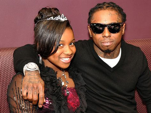 Reginae Cater with her father, Lil Wayne.